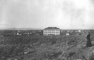 The Academy Building in 1906. Notice how it rises above the surrounding sagebrush; easy to see flames on the roof.